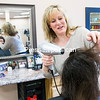 GABE DICKENS/P-R PHOTO 4-13-2016<br /> Kelli Calongne, who has 27 years experience as a hairdresser and 10 years as an owner in the hair salon business, opened Hair Force 1 Salon and Spa in November at Suite 103, 285 Tom Miller Road in the Town of Plattsburgh. The salon's experienced staff offers all the latest techniques and trends in hair styling and coloring, including ombre and balayage, along with manicures, pedicures and spa pedicures in a private room. Hours of operation are 9 a.m. to 7 p.m. Tuesday through Thursday, 9 a.m. to 5 p.m. Fridays and 9 a.m. to 4 p.m. Saturdays. For more information, call 825-1111.