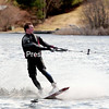 JACK LADUKE/P-R PHOTO 4-28-2016<br /> Justin Somero, 17, of New Hampshire rides the surf on a wakeboard over the choppy waters of Lake Flower in Saranac Lake for his first time out on a chilly day this spring. He is being towed by a 100-HP Sea-Doo Spark Sled operated by Christian Thomas of Bloomingdale. Now that the ice is out of most northern New York lakes and ponds, expect to see more recreational craft out there.