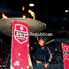 Tyler Carter, 22, of Topton, Pa., lights the cauldron at the Opening Ceremonies of the 36th-annual Empire State Winter Games Thursday night in Lake Placid. More then 1,500 athletes will take part in the competition over the weekend. Carter will participate on the Paralympic Alpine ski team. His leg was amputated below the knee as the result of a birth defect.  (JACK LADUKE/P-R PHOTO)