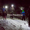 Cross country skiers take advantage of a few inches of fresh powder to ski the groomed trails at the Cascade Cross Country Ski Center in Lake Placid Friday evening for the center's weekly Friday Night Farm Dinner, featuring local food, live music and night skiing. (GABE DICKENS/P-R PHOTO)