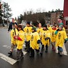 Nick Munn, 10, carries the Empire State Winter Games torch in downtown Saranac Lake on Wednesday, accompanied by other students from Petrova Elementary School. The final leg sets out at 3:30 p.m. today from the Lake Placid Boat House on Parkside Drive at the public beach. It will travel around Mirror Lake, past the Lake Placid boat launch, Mirror Lake Inn and High Peaks Resort and then move down Main Street and arrive at Stewart's Shop at 4:30 p.m. It will eventually make its way into the 1980 Herb Brooks Arena for the 6 p.m. Opening Ceremony. (JACK LADUKE/P-R PHOTO)