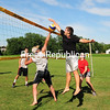 ROB FOUNTAIN/STAFF PHOTO 8-1-2016<br /> Team Giroux (left side of net) battles against Team KR Constructing in the championship volleyball match Sunday during the Chazy Old Home Day at the recreation park. Team KR Constructing defeated Team Giroux 24 to 19 for the title. The day included an antique car show, barbecue, music, kids games and more. The event is sponsored by the Chazy Lions Club.