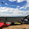 MIKE PITTS/P-R PHOTO  7-5-2016<br /> Julie LaRocque of Drummondville, Quebec, (left) and Eric Robitaille of Valley Field, Quebec, (far right) provide support for fellow windsurfer Remi Bretton of Drummondville at Ausable Point Beach Campgrounds. The three are camping with friends and family during the holiday weekend.