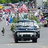 ROB FOUNTAIN/STAFF PHOTO  7-5-2016<br /> Lady Liberty greets the crowd on Bridge Street during the City of Plattsburgh's Fourth of the July parade Monday. For more Fourth of July photos from around the region, see page A3.