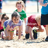 GABE DICKENS/P-R PHOTO<br /> Children scramble through an obstacle course at Plattsburgh City Beach during the Champlain Valley Family Center's annual 5K Forward for Recovery Race. The organization hopes funds raised from the recent event, which also included a raffle for a 1965 Ford Mustang, will bring them closer to their goal of $30,000, a part of which will bring back their youth summer program, along with funding their substance abuse prevention programs.