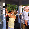 "CELEBRATING WILLSBORO HISTORY<br /> ALVIN REINER/P-R PHOTO 7-26-2016<br /> Visitors check out the newly erected history kiosk at the Willsboro History Center. A standing-room-only crowd attended the recent opening ceremony for the kiosk, which features eight large panels depicting the town's 250-year history. Much of the $44,000 used for the facility's construction came through the J.C. Kellogg Foundation and Patty Paine. The kiosk was dedicated to Ken and Marilyn Cole ""for their love of the beauty and history of Willsboro, Lake Champlain and the Adirondacks."" Willsboro Town Historian Ron Bruno collaborated with graphics designer Rob Powell and editor Mary Bell to create the historic panels. The kiosk is located by the State Route 22 bridge spanning the Boquet River and Paine Memorial Library in Willsboro."