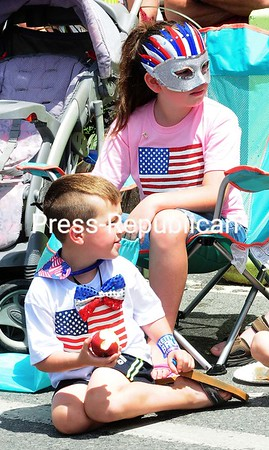 Rylee (top) and Tanner Adams show off some American color while waiting for the parade to head down City Hall Place during Monday's City of Plattsburgh Fourth of July Celebration.<br /> ROB FOUNTAIN/STAFF PHOTO 7-5-2016