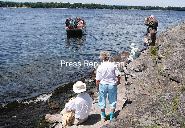 ROB FOUNTAIN/STAFF PHOTO 7-26-2016 People wait on the Valcour Island shore after touring the Bluff Point Lighthouse on Sunday; free transportation to and from the Peru Boat Dock was provided by the State Department of Environmental Conservation.
