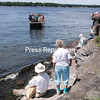 ROB FOUNTAIN/STAFF PHOTO 7-26-2016<br /> People wait on the Valcour Island shore after touring the Bluff Point Lighthouse on Sunday; free transportation to and from the Peru Boat Dock was provided by the State Department of Environmental Conservation.