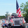 Antique Jeeps line Bridge Street showing their patriotic colors during the City of Plattsburgh's Fourth of July Celebration. The event included a parade, music, food and more.<br /> ROB FOUNTAIN/STAFF PHOTO  7-5-2016