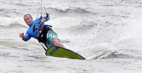 ROB FOUNTAIN/STAFF PHOTO 7-1-2016<br /> Strong winds and choppy waves make for perfect conditions for kite boarders to tackle the waters of Lake Champlain on Cumberland Bay near Plattsburgh City Beach. The forecast for the next few days calls for cloudy skies with temperatures in the high 70s.
