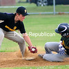 ROB FOUNTAIN/STAFF PHOTO 7-19-2016<br /> McSweeney's runner Connor Myers (10) slides safely into second on a steal with the late tag from City Police's Isaac Garma (10) during Game 1 of the Plattsburgh Baseball Club championship series Monday at Lefty Wilson Field. For more on the game, see B2.