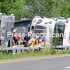 ROB FOUNTAIN/STAFF PHOTO 7-20-2016<br /> A tractor-trailer sits on its side on Route 57 near Cumberland Head Corners in Plattsburgh not far from the Interstate 87 intersection Tuesday morning. It appeared there were no injuries in the wreck. The driver of a rig that rolled down an embankment in Brainardsville about an hour earlier was not seriously injured.