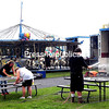 ROB FOUNTAIN/STAFF PHOTO  7-20-16<br /> Clinton County Fair workers clean tables and equipment and set up rides Monday at the fairgrounds in Morrisonville in preparation for today's opening. The fair runs through Sunday, offering music, food, games, rides and more.