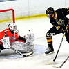Plattsburgh High goalie Dean Dashnaw (30) denies Lake Placid's Bjorn Kroes (9) Wednesday during CVAC hockey action at A-C North in Plattsburgh. Kroes had two helpers in the Blue Bombers' victory.  (ROB FOUNTAIN/STAFF PHOTO)