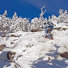 Under bluebird skies, Keeseville resident Ruby Salley negotiates around some tricky, icy areas on her ascent of Giant Mountain. She carried a full winter pack (full of extra clothing, food, water and emergency equipment) to be prepared for the high winds and below-zero temperatures she encountered on the summit. Salley hiked the three-mile Zander Scott Trail, also known as the Ridge Trail, with parking on Route 73, 4.8 miles south of the High Peaks sign in Keene Valley. (JOANNE KENNEDY)
