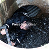 A New York State Trooper pulls himself out from a sewer pipe beneath the streets of Dannemora after checking for any sign of Sweat and Matt Friday afternoon.