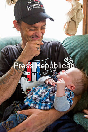 GABE DICKENS/P-R PHOTO   6-19-2016 John See smiles while gazing down at his two-month old son, Colton. John has rearranged his schedule to look after the infant during on weekdays when his wife, Lee, returns to work after her maternity leave ends.