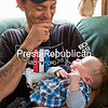 GABE DICKENS/P-R PHOTO   6-19-2016<br /> John See smiles while gazing down at his two-month old son, Colton. John has rearranged his schedule to look after the infant during on weekdays when his wife, Lee, returns to work after her maternity leave ends.