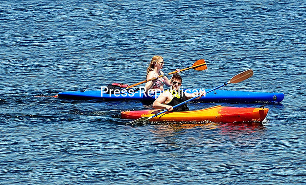 ROB FOUNTAIN/STAFF PHOTO  6-20-2016<br /> Kayakers paddle in stereo across the waters of Lake Champlain Wednesday on Cumberland Head near the ferry in Plattsburgh.