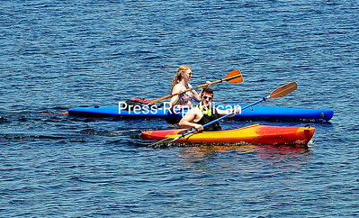 ROB FOUNTAIN/STAFF PHOTO  6-20-2016 Kayakers paddle in stereo across the waters of Lake Champlain Wednesday on Cumberland Head near the ferry in Plattsburgh.