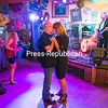 GABE DICKENS/P-R PHOTO  6-27-2016<br /> Plattsburgh residents Anne Yanulavich and Frank Harvey slow-dance to one of the more mellow songs by the Paul DesLauriers Band, a blues-rock trio from Montreal featuring singer-guitarist Paul DesLauriers, bassist Greg Morency and drummer Sam Harrisson, during a recent Plattsburgh Blues and Jazz show at the Naked Turtle. On Sunday, July 17, the Champlain Wine Company will host a performance by Toronzo Cannon, and starting on Saturday, July 29, a two-day Plattsburgh Blues and Jazz festival, Summertime Blues in the Burgh, will feature Victor Wainwright and the Wildroots; Sugar Ray and the Bluetones; Joe Louis Walker and more.
