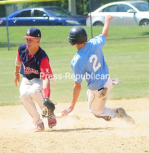ROB FOUNTAIN/STAFF PHOTO  6-20-2016 Mariners' runner Keller Kowalowski (2) steals second base under Schenectady Indian's short stop Marty McCollum (12) Sunday during the Mehan-Turner Memorial Tournament at Left Wilson Field in Plattsburgh.