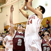 "Moriah's Adam Jaquish (24) goes for a shot over Chateaugay's Chandler LaPlante (2) and Jamie Rabideau (22) Wednesday during the Cladd D NYS Regional Semi-Final game at SUNY Plattsburgh Fieldhouse.<br /> Bouns at  <a href=""http://www.pressrepublican.com"">http://www.pressrepublican.com</a>. (ROB FOUNTAIN/STAFF PHOTO"