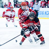 GABE DICKENS/PR-PHOTO) 3-20-2016<br /> Kayla Meneghin (9) collides with Wisconin-River Falls' Dani Bueher during Saturday's game at Stafford Ice Area.