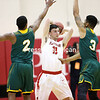 Plattsburgh's Zack Coleman gets double-teamed by Fitchburg's Jaieel Bell (left) and Josh Bosworth during the opening round of the NCAA Division III men's basketball tournament. (GABE DICKENS/PR-PHOTO)