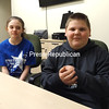 ASHLEIGH LIVINGSTON/STAFF PHOTO 3-24-2016<br /> Northern Adirondack sixth-grader Jayden Chase (right) demonstrates how he put his hand over his fist to perform the Heimlich maneuver on classmate Alexis Belrose (left) when she was choking recently in the school cafeteria. Jayden's parents, Jessica and Ron, just recently taught their son the procedure.