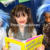 "ALVIN REINER/P-R PHOTO<br /> Elizabethtown-Lewis Central School second-graders Julia Denton (from left), Jerzey Heald and Amari Wilson, garbed as Dr. Seuss characters, pore over ""Wacky Wednesday"" during the school's annual celebration to honor Theodor Seuss Geisel, aka Dr. Seuss. The event was based on the book, ""Wacky Wednesday,"" which became reality as winter weather closed school for the day, and so ""Wacky Wednesday"" became ""Wacky Thursday."" Wacky stories, a large Scrabble game and other activities entertained the students, who each replaced the first consonant sound in their names with a W. The event, marking Dr. Seuss's 112th birthday, coincided with National Read Across America Day."