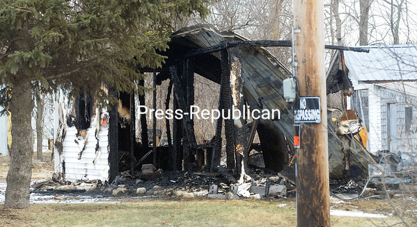 ROB FOUNTAIN/STAFF PHOTO<br /> Flames destroyed this vacant residence at 489 Perry Mills Road in Champlain early Sunday March 6, 2016 morning. According to Champlain Second Asst. Fire Chief Corby LaFave, report of the blaze at the abandoned home came in just after 1 a.m. No one was injured in the incident, he said, and there was no reason to think the fire was of suspicious origin. The cause and origin of the blaze were still under investigation Sunday afternoon.