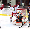 ROB FOUNTAIN/STAFF PHOTO<br /> Plattsburgh State's Karen Hudson (19) celebrates her goal with teammate Muna Fadel (27) in front of Utica goalie Keira Goin and Danielle Haasbeek Sunday March 6, 2-016 during the Women's Hockey ECAC West Tournament.