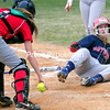 ROB FOUNTAIN/STAFF PHOTO 5-5-2016<br /> AuSable Valley's Dru Gravelle slides safely into home despite the efforts of Saranac Lake catcher Iris Glinski Wednesday in Clintonville.