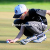 ROB FOUNTAIN/STAFF PHOTO  5-20-2016<br /> AuSable Valley's Jeffrey Miller sets up for his putt on the last hole Wednesday during a CVAC golf match against Peru at Adirondack Golf Club.