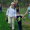 ALVIN REINER/P-R PHOTO  5-17-2016<br /> For some, the recent Champlain Area Trail System's Grand Hike was a family affair, as Mary Anne Mangano of Essex is joined by her daughter Stephanie Smart, with husband, Patrick, and youngsters, 4-year-old Owen and Ryan, riding in his dad's carrier. Approximately 200 hikers and an assortment of dogs took the healthy trek, 11 or so miles through the woods and across fields, from the Town of Westport hamlet of Wadhams to the center of the Town of Essex, as they enjoyed a spring day and the third-annual event hosted by CATS.