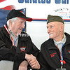 "ALAN CARLON GOODMAN/STAFF PHOTO  5-17-2016<br /> Lawrence ""Larry"" Solvay and Robert ""Bob"" Byno greet each other at the recent send-off of North Country Honor Flight XIV at Plattsburgh International Airport. Solvay, from Fort Covington, was a personnel clerk with the U.S. Army in Germany, traveling on temporary assignment to many locations in Europe. Byno, from Saranac Lake, served in the Pacific from the Gilbert Islands to the Marshalls as a Marine Corps rear gunner in a dive bomber. He and his pilot served 13 months together, including a 139-mission stint in just 10 months. Byno was awarded six Distinguished Flying Crosses and 21 Air Medals. As of Saturday's flight, 212 veterans from the region experienced the all-expense-paid trip to Washington, D.C. Remaining 2016 Honor Flights are set for June 4 and 18 and Sept. 10. For additional information, go to nchonorflight.com."