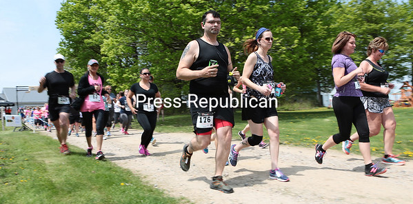 Athletes take off from the starting line at the second-annual Run For Wine 5K at Vesco Ridge Vineyards in West Chazy. At the conclusion of the race, participants, about 200 taking part in all, received a glass of wine or beer with vegetarian chili. Proceeds from the half-marathon benefit the Adirondack Young Professionals. GABE DICKENS/P-R PHOTO  5-24-2016