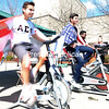 ROB FOUNTAIN/STAFF PHOTO 5-1-2016<br /> Alpha Sigma Phi members Jonathan Gamboa (left) and Basel Farhat take their turn on the bike to raise money for the Homes for Troops charity during a recent bike-a-thon outside SUNY Plattsburgh's Angell College Center. The yearly fundraiser started at noon and went until midnight. The group's goal was to raise $400.