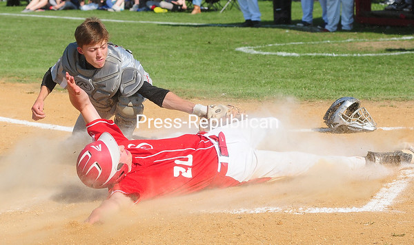 ROB FOUNTAIN/STAFF PHOTOS  5-24-2016<br /> Saranac's Logan Matthews (20) slides in safe under the tag of Beekmantown catcher Keller Kowalowski (8) during a Section VII Class B baseball semifinal Monday in Beekmantown.