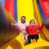 """ROB FOUNTAIN/STAFF PHOTO 5-4-2016<br /> First-year Clinton Community College students Domenic Trombley and Kristen Duso descend a slide, racing each other to the finish on a huge inflatable obstacle course set up Tuesday on the Plattsburgh college's grass oval. To encourage students to participate in the Come and Play event, professors were offering bonus points for students to go through the course. """"Who can't use bonus points?"""" said Duso. """"It's a great stress reliever too."""""""