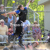 ROB FOUNTAIN/STAFF PHOTO  5-24-2016<br /> Plattsburgh High runner Shea Frady slides safely into home under Peru catcher Brittany Miner Tuesday during a Class B softball semifinal at Cardinal Park in Plattsburgh.