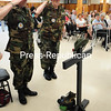 ROB FOUNTAIN/STAFF PHOTO  5-31-2016<br /> Veterans Joe Geer (left) and Terry Morris place a hat on the memorial of fallen soldiers Monday during the Memorial Day Remembrance service at American Legion Post 20 in Plattsburgh. The guest speaker for the event was veteran Daniel Kaifetz. A variety of events around the North Country marked the day of remembrance with parades, wreath layings and discounts for service members at local restaurants.