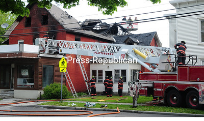 ROB FOUNTAIN/STAFF PHOTOS  5-23-2016 Firefighters work to extinguish an apartment building fire in Plattsburgh early Sunday. Geoffrey A. Brenno and Joseph Congelosi, both 34, died in the blaze that destroyed the multi-story brick building at 220 Margaret St., City Police Chief Desmond Racicot told the Press-Republican Sunday afternoon.