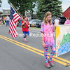 ROB FOUNTAIN/STAFF PHOTOS    5-30-2016<br /> The Chazy Girl Scouts march down Route 9 Sunday during the Memorial Day Parade in Chazy. The parade started at the recreation park and ended at the American legion Post 767 and featured antique cars, floats, dance groups, U.S. Border Customs Color Guard and various fire departments.