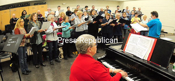"""ROB FOUNTAIN/STAFF PHOTOS 12-1-2016 Timothy Morningstar directs the Champlain Valley Voices with accompaniment from Leslie Scholtz in preparation for the group's """"The Magic of Christmas"""" performance set for 7:30 p.m. Saturday at Plattsburgh United Methodist Church."""