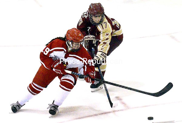 ROB FOUNTAIN/STAFF PHOTO  11-17-2016<br /> Plattsburgh's Karen Hudson (19) battles for position on the puck with Norwich's Bryn Labbe (17) Wednesday during women's hockey at the Plattsburgh State Field House.