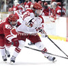 GABE DICKENS/P-R PHOTO 11-19-2016<br /> Plattsburgh State's Chris Taff carries the puck into the offensive zone while Cortland's Stefano Alonzi attempts a poke check during Friday's SUNYAC men's hockey game at Stafford Ice Arena.