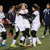 ROB FOUNTAIN/STAFF PHOTO  11-3-2016<br /> Northern Adirondack's Katee Brothers (5) is mobbed by teammates after scoring the second goal of the game against Potsdam Tuesday during a girls' soccer Class C regional semifinal in Plattsburgh.